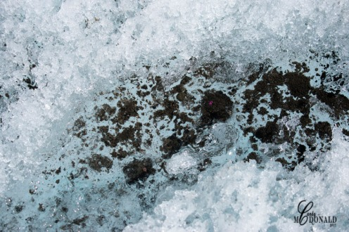 Icy blue water on glacier 2