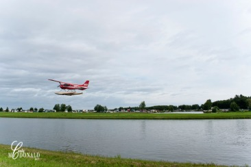 Plane taking off from water runway