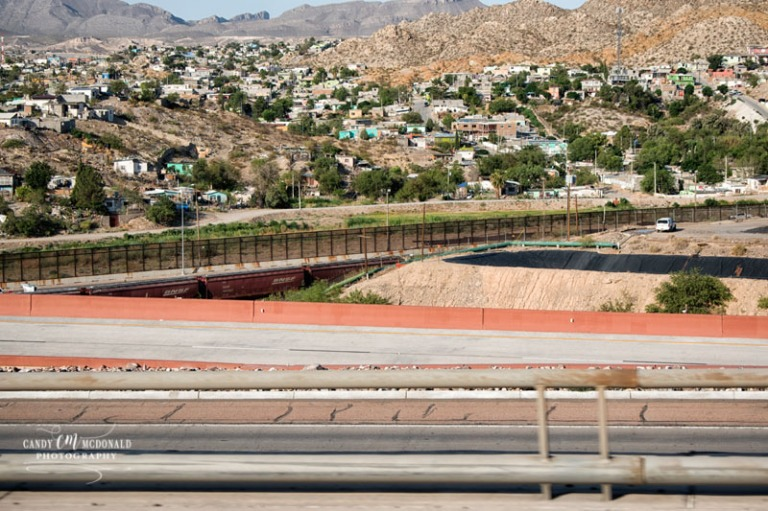 The US/Mexico border fence line in El Paso, Texas as seen from westbound I-10