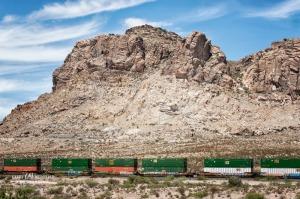 Train running through the desert of NM