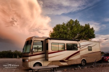 Storm clouds gather behind RV in a Willcox, AZ campsite